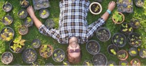 Nick Cooper lying with his seedlings!